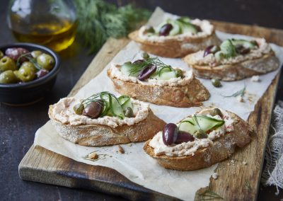 Salmon Bruschetta with Pickled Cucumber, Olives and Capers